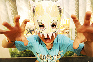 Boy in dinosaur mask.