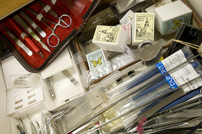 Assorted forceps, pins, and other entomological equipment