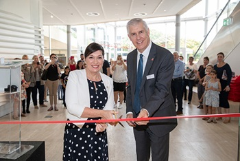 Leeanne Enoch & Jim Thompson snipping the ribbon at the ANZAC Legacy Gallery opening